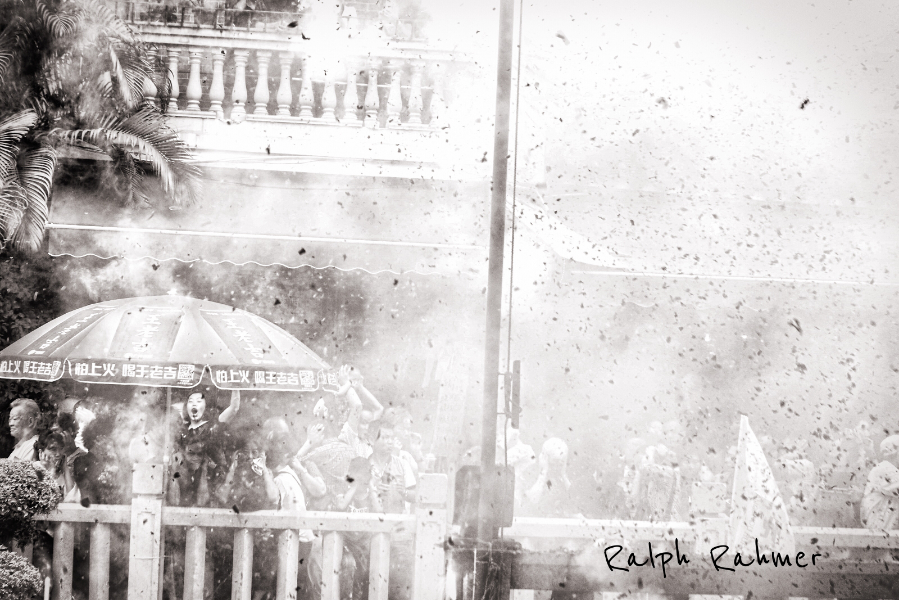Black and white photography of people celebrating in the smoke of a firecracker explosion. Excited athmosphere