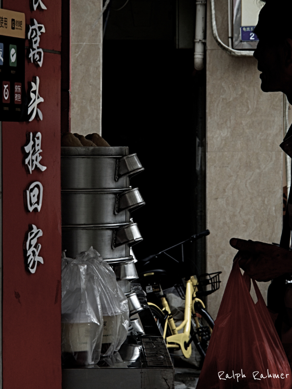 Silhouette of a man buying lunch at a Street Restaurant